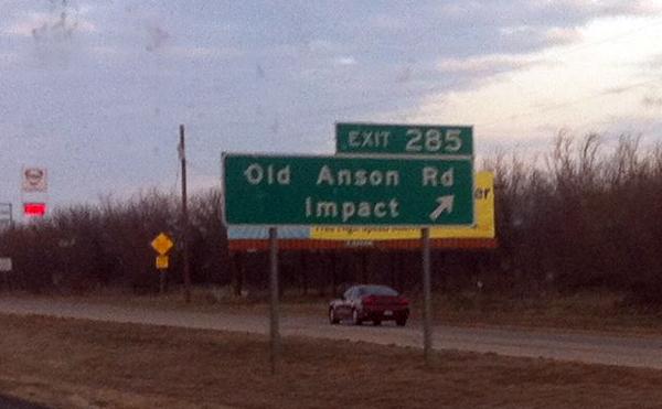 photo of raod sign near abilene, TX for Impact
